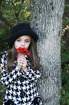 Girl By Tree With Flower Stock Photo