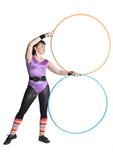 Young Woman With Two Gymnastics Rings Royalty Free Stock Images