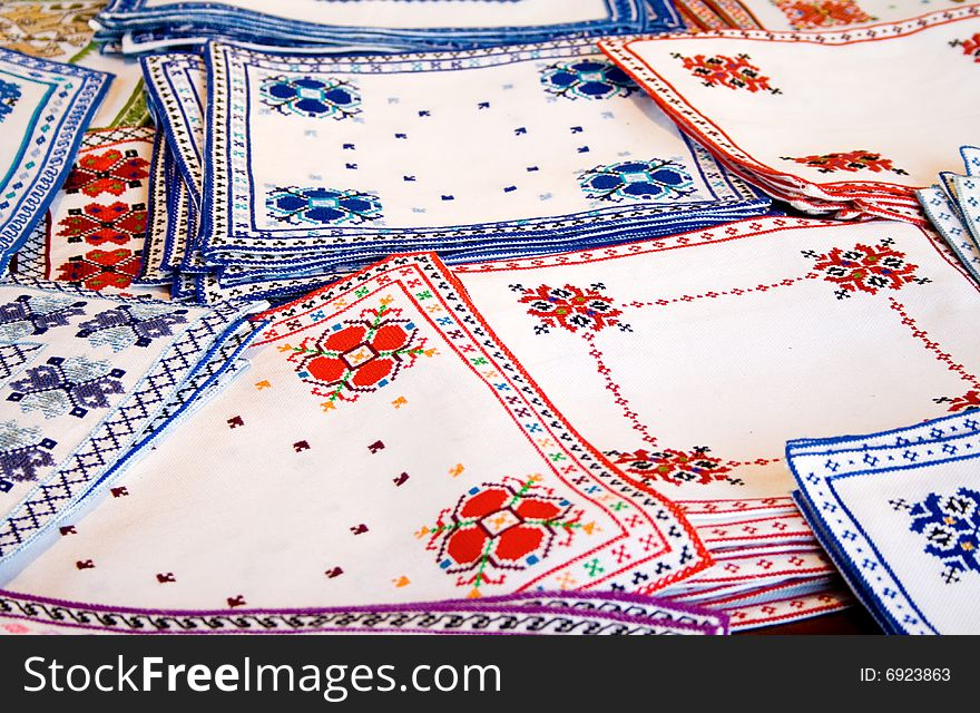 White fabrics with colorful embroidery