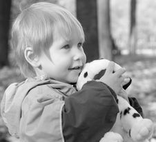 Free The Child Embraces A Toy Stock Photos - 6933333