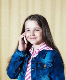 Girl In A Blue Denim Jacket Talking On A Phone Royalty Free Stock Photos