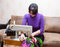 Free Woman Sews On The Sewing Machine Stock Photos - 69514433