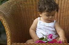 Free Child, Chair And Orchids Royalty Free Stock Images - 75969