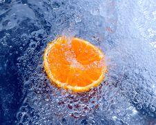 Free Orange Splashing Water Royalty Free Stock Images - 700269