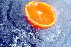 Free Orange Splashing Water Stock Photo - 700270