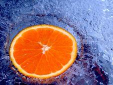 Free Orange Splashing Water Stock Images - 700274