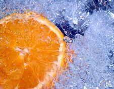 Free Orange Splashing Water Stock Photography - 700292