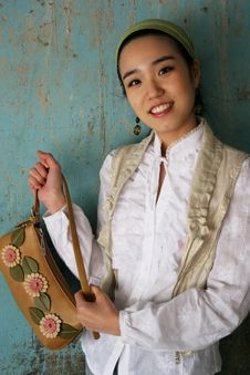 Free Asian Woman Holding A Handbag Royalty Free Stock Images - 703609