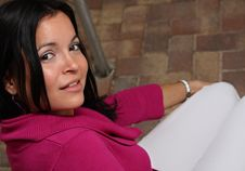 Woman Smiling Over Her Shoulder Royalty Free Stock Image