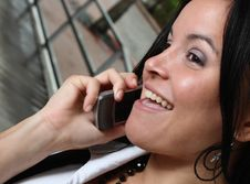 Free Woman Laughing On The Phone Stock Photo - 7007740