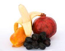 Banana, Pomegranate, Carambola, And Grapes Stock Photo