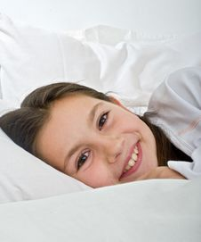 Young Girl Lying In Bed Royalty Free Stock Image