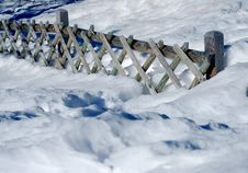 Free Wooden Fence On Snow Royalty Free Stock Image - 7010166
