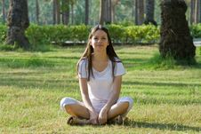 Beautiful Woman Sitting In A Park Stock Images