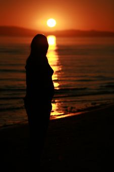 Pregnant Woman At Sunset Stock Photos