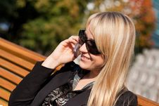 Businesswoman In Sunglasses With Laptop Sitting On Royalty Free Stock Photos