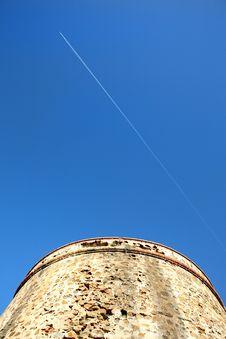 Moorish Tower Blue Sky And Aeroplane Royalty Free Stock Photo
