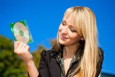 Free Businesswoman Holding CD Stock Photos - 7022663