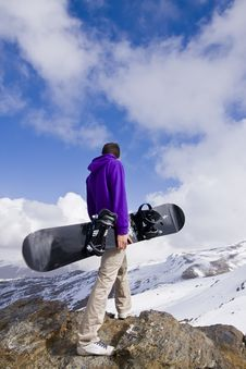 Snowboarder At The Top Of The Hill Royalty Free Stock Images
