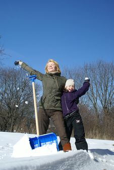 Free Mother And Her Daughter On A Winter Background Stock Image - 7023261