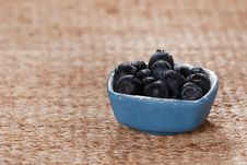 Free Blueberries In A Small Blue Dish On Rustic Stock Photos - 7024493