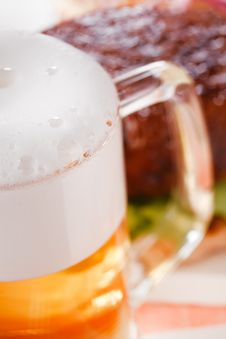 Free Pint Of Lager Beer With Burger On Background Royalty Free Stock Photo - 7024515