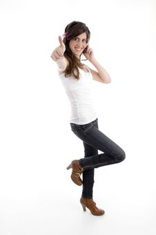 Free Standing Woman With Cell Phone Wishing Good Luck Stock Image - 7025891