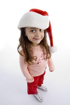 Free Standing Little Girl With Christmas Hat Stock Photos - 7025953
