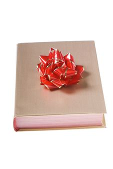 Book Wrapped In Gold With Red Yellow Bow Royalty Free Stock Photo