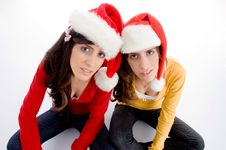 Free Sitting Females With Christmas Hat Stock Photography - 7026102