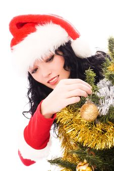 Free Woman Decorating A Christmas Tree Stock Images - 7026684