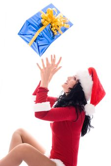 Free Girl Catching A Christmas Present Royalty Free Stock Image - 7026836
