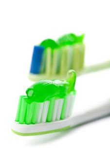 Free Two Toothbrushes With Green Toothpaste Isolated Royalty Free Stock Photos - 7029038