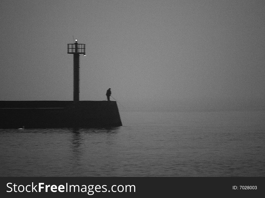 A fisherman on the pier