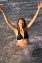 Free Woman Splashing In Ocean Stock Photo - 7037120