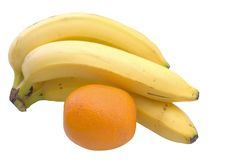 Free Cluster Of Bananas And Orange Stock Photo - 7033320