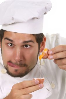Free Young Funny Chef Cracking An Egg Royalty Free Stock Image - 7033376