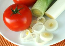 Free Tomato And Leek On A Plate Royalty Free Stock Images - 7033829