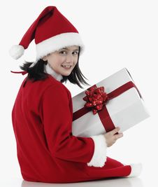 Free X-mas Little Girl With Huge Present Stock Photos - 7036253
