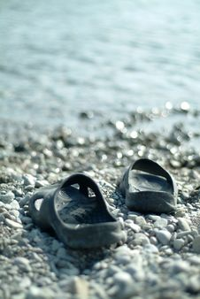 Free Slippers At The Sea Royalty Free Stock Images - 7036579