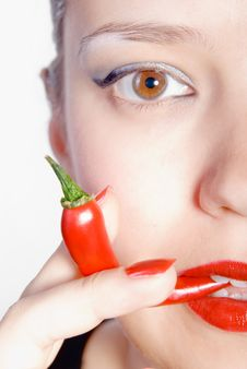 Free Biting Red Hot Chili Pepper Royalty Free Stock Photography - 7036937