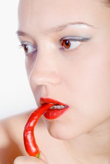 Free Biting Red Hot Chili Pepper Stock Photos - 7037063