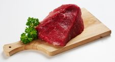 Piece Of Beef On Wooden Desk Royalty Free Stock Photo