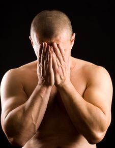 Muscular Man Covering His Face With The Hands Stock Image