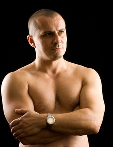 Muscular Man Isolated On Black Stock Photos