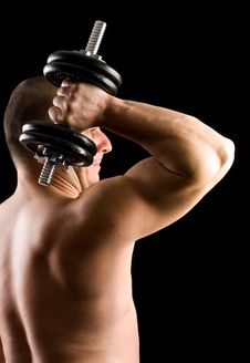 Man Lifting Weights Isolated On Black Royalty Free Stock Image