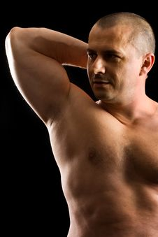 Muscular Man With His Arm Up Isolated On Black Stock Photography