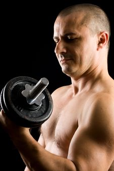 Man Lifting Weights Isolated On Black Royalty Free Stock Photos