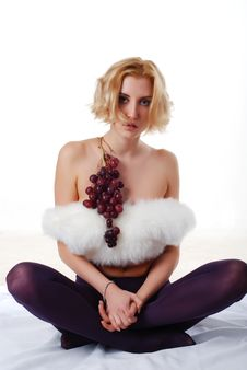 Woman With Bunch Of Grapes Royalty Free Stock Images