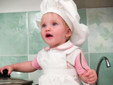 Free Girl On Kitchen Stock Images - 7038994